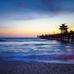 San Clemente pier at sunset photography. San Clemente California is a popular coastal city in Orange County in the United States of America. Copyright ⓒ 2017 Paul Velgos with all rights reserved.