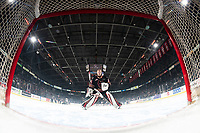 KELOWNA, BC - FEBRUARY 17: Brayden Peters #35 of the Calgary Hitmen skates to the net at the start of first period against the Kelowna Rockets at Prospera Place on February 17, 2020 in Kelowna, Canada. (Photo by Marissa Baecker/Shoot the Breeze)