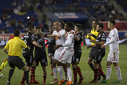 March 13, 2018 - Harrison, New Jersey, United States - Aurelien Collin (78) of Red Bulls & Pablo Aguilar (12) of Club Tijuana fight during Scotiabank Concacaf Champions League quarterfinal second leg game at Red Bull Arena Red Bulls won 3 - 1  (Credit Image: © Lev Radin/Pacific Press via ZUMA Wire)