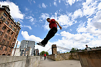 Parkour athletes executes some moves on the Broomielaw in Glasgow