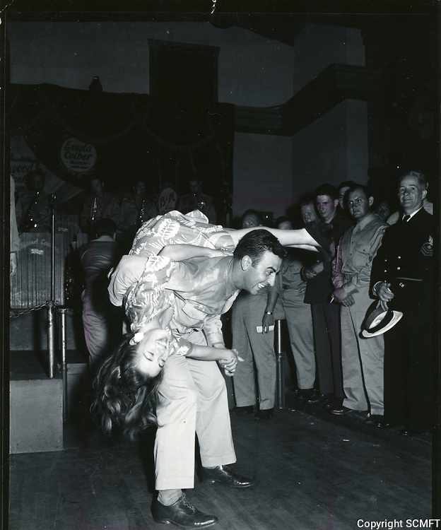 1944 Sally Butterfly dancing the jitterbug with PFC A. DeFlaminis at the Hollywood Canteen