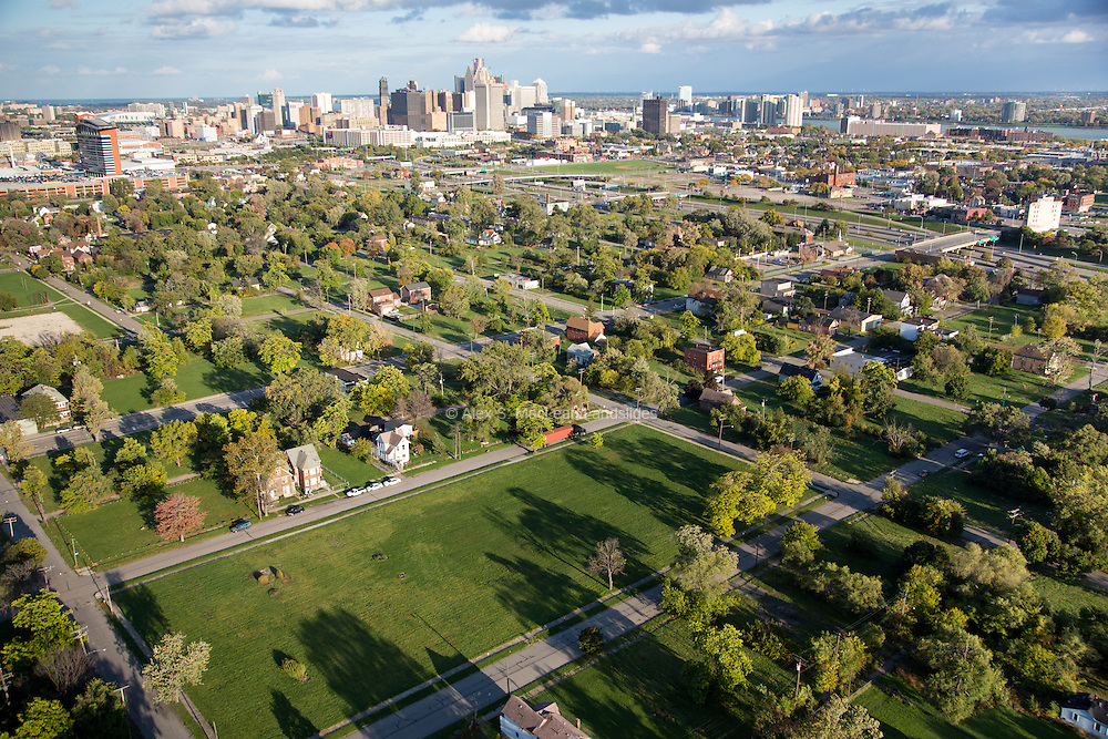 """A green city block was once the site of John A. Owen Elementary School, recently demolished as part of a Detroit Public School initiative. Abandoned schools were referred to as an """"eyesore"""" and """"public safety threat"""", adding to the city's blight."""