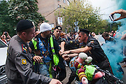 17/08/2012, Moscow, Russia..Police seize a protester on a bicycle who had let off a flare outside the court as Maria Alyokhina, Yekaterina Samutsevich and Nadezhda Tolokonnikova of punk band Pussy Riot are sentenced to two years prison for their performance in the Christ The Saviour Cathedral.