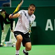 NLD/Rotterdam/20100209 - ABN - Amro Tennistoernooi 2010, Andrey Golubev - Mikhail Youzhny (gele racket)
