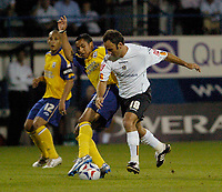 Photo: Leigh Quinnell.<br /> Luton Town v Southampton. Coca Cola Championship.<br /> 09/08/2005. Southamptons Theo Walcott is pushed aside by Lutons Ahmet Brkovic.