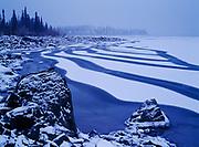 Wind fracturing early winter ice on Kluane Lake during freeze-up, Kluane National Park, Yukon Territory, Canada.