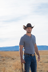 All American Cowboy standing on a ranch