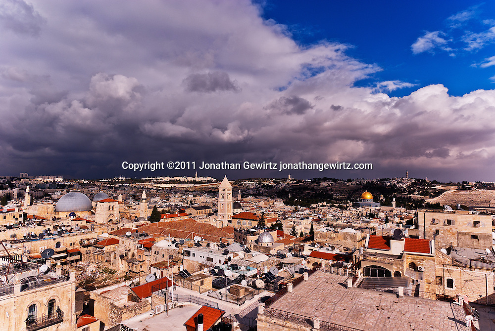 Skyline of the Old City of Jerusalem as seen from the Tower of David against a backdrop of winter storm clouds. WATERMARKS WILL NOT APPEAR ON PRINTS OR LICENSED IMAGES.