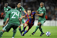 FOOTBALL - CHAMPIONS LEAGUE 2010/2011 - GROUP STAGE - GROUP D - FC BARCELONA v PANATHINAIKOS - 14/09/2010 - PHOTO JEAN MARIE HERVIO / DPPI - ANDRES INIESTA (FCB) / CEDRIC KANTE (PAN)