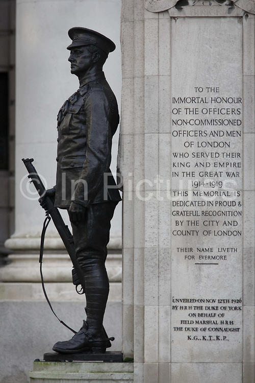 In the 100th year after WW1 started, the war memorial hero in Cornhill, City of London remembering those killed in the First World War, lost in the trenches and the fields of Flanders from 1914-19. Dedicated by the City of London, the UK capital's financial and historic heart. Two soldiers face away from each other with rifles between their boots, they represent a lost generation when the nation's youth sacrificed their lives in the 20th century's first great conflict. The inscription says that their names will live for evermore.