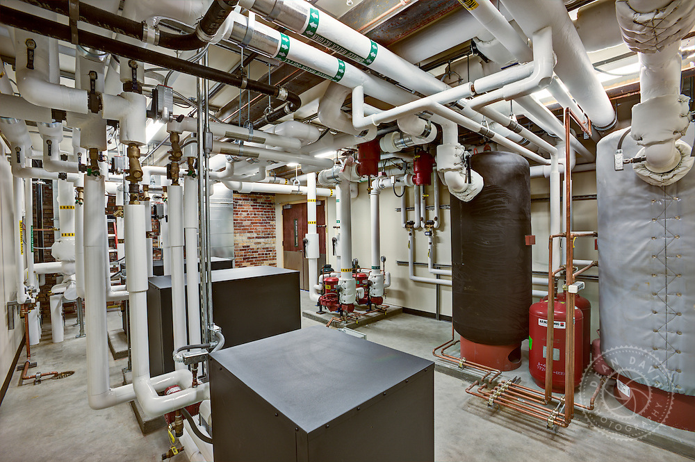 Dean Davis is a commercial photographer based in Spokane Washington and focuses on architecture, heavy industry, advertising, banking, transportation as well as personal fine art work. This is an architectural interior image of a mechanical room made for McKinstry at their McKinstry Station location on the Spokane River.