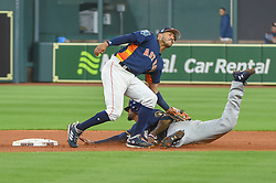 March 26, 2018 - Houston, TX, U.S. - HOUSTON, TX - MARCH 26: Houston Astros infielder Carlos Correa (1) picks off Milwaukee Brewers outfielder Lorenzo Cain (6) at second base during the game between the Milwaukee Brewers and Houston Astros at Minute Maid Park on March 26, 2018 in Houston, Texas. (Photo by Ken Murray/Icon Sportswire) (Credit Image: © Ken Murray/Icon SMI via ZUMA Press)
