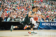 29 MAR 2015: Travis Trice (20) of Michigan State University dribbles downcourt againts Quentin Snider (2) of the University of Louisville during the 2015 NCAA Men's Basketball Tournament held at the Carrier Dome in Syracuse, NY. Michigan State defeated Louisville 76-70 to advance. Brett Wilhelm/NCAA Photos