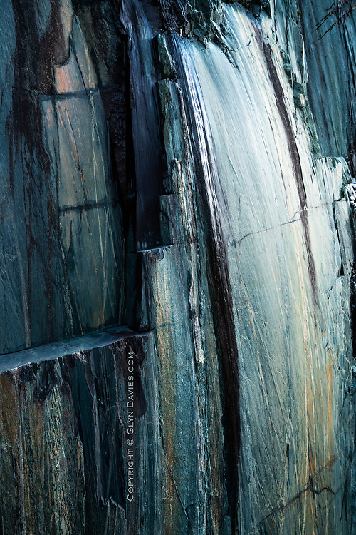 Unbelievably beautiful shapes, colours and textures in a cliff of slate in the Llanberis slate quarries. It was more reminiscent of an oil painting than a disused quarry face.<br /> <br /> UNESCO World Heritage Site