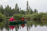 Brule River fishing guide Damian Wilmot (left) fishes the upper Brule with angler Matson Holbrook in a 1900-era Joe Lucius guide canoe Wilmot meticulously restored over the course of two years.