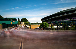 Spectators are led into the grounds at the start of day three of the Wimbledon Championships at the All England Lawn Tennis and Croquet Club, Wimbledon.