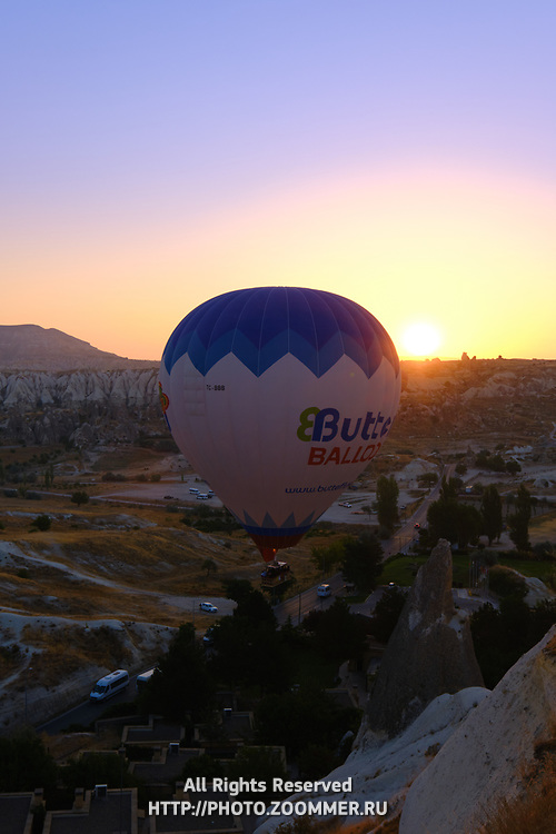 Hot air balloon fly in the morning over rising sun, Cappadocia, Turkey