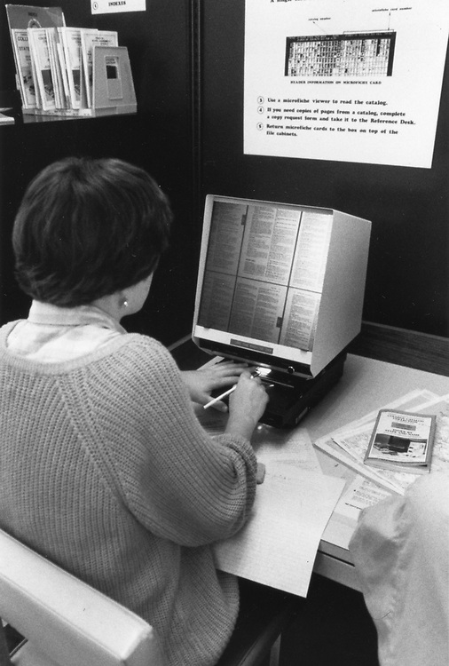 ©1992 college student using microfiche in library
