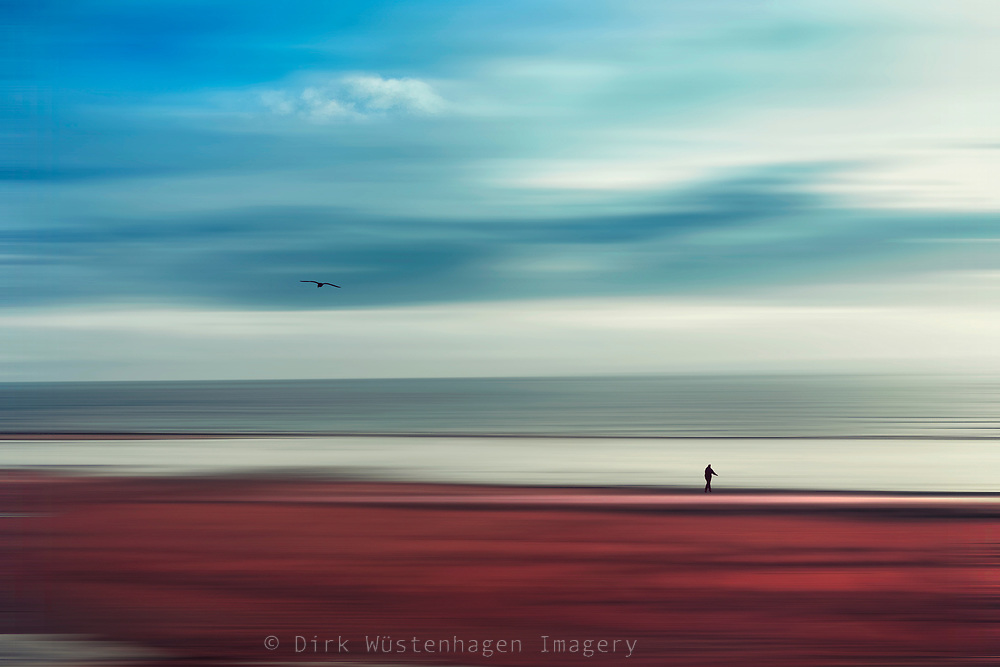 Abstract seascape and beach with lone wanderer