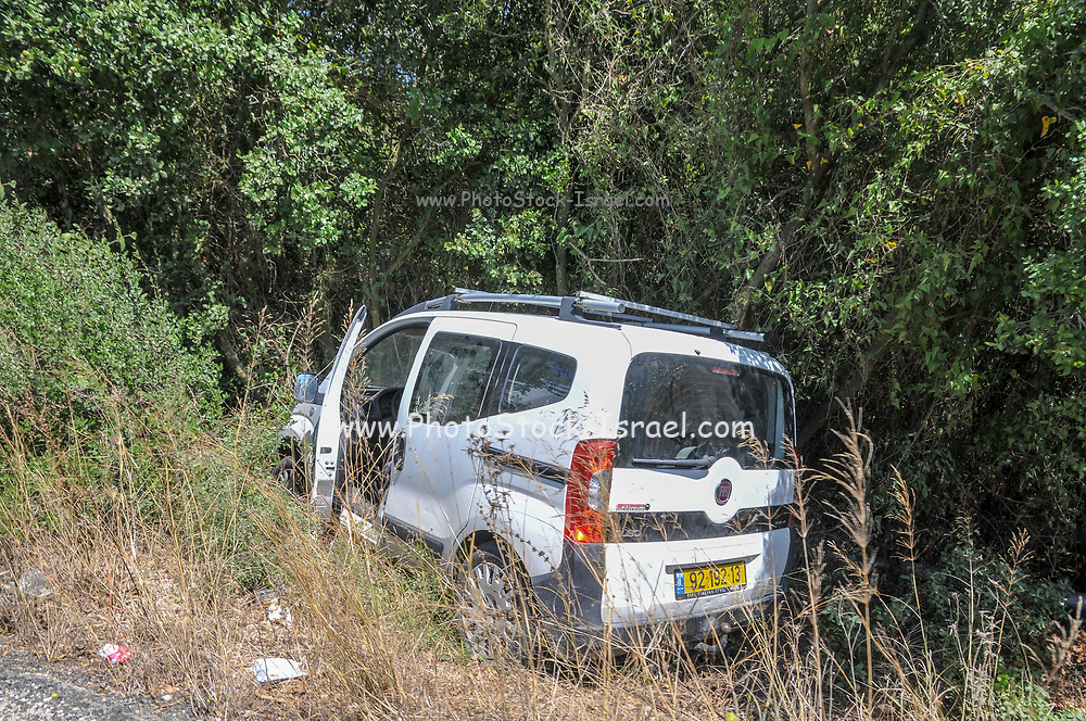 Car in a ditch on the side of the road after the driver had lost control