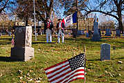 11 NOVEMBER 2020 - DES MOINES, IOWA: ALAN WENGER, left, and MIKE ROWLEY, members of Sons of the Revolution, read the names of veterans buried in Woodland Cemetery during the Veterans' Day service in Woodlawn Cemetery in Des Moines. Volunteers read the names of the approximately 1,000 veterans buried in the cemetery. The observance at Woodland Cemetery was one of the few live Veterans Day ceremonies in the Des Moines area this year. Most were held online only because of the Coronavirus pandemic.    PHOTO BY JACK KURTZ