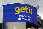Advertising on the large screens at Piccadilly Circus for the groceries shopping company Getir on 25th May 2021 in London, United Kingdom. Getir is a Turkish start-up founded in 2015. Through its mobile app, it offers an on-demand ultrafast delivery service for grocery items, in addition to a courier service for restaurant food deliveries.