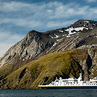 The National Geographic Orion ship anchored at Elsehul, a bay on the northwest coast of South Georgia Island.