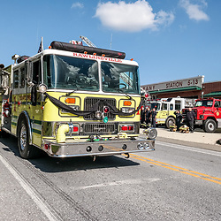 Peach Bottom, PA, USA - October 30, 2014: A fire truck adorned with black bunting carries the casket of fallen volunteer firefighter Christi Marie Rodgers.