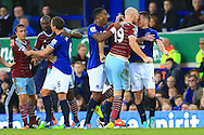 West Ham's James Collins goes head to head with James McCarthy of Everton following a challenge - Everton vs. West Ham United - Barclay's Premier League - Goodison Park - Liverpool - 22/11/2014 Pic Philip Oldham/Sportimage