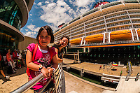 Passengers waiting to board the new Disney Dream cruise ship, Port Canaveral, Florida USA