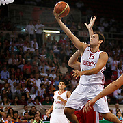 Turkey's Ender ARSLAN (R) during their Istanbul CUP 2011match played Montenegro between Turkey at Abdi Ipekci Arena in Istanbul, Turkey on 25 August 2011. Photo by TURKPIX
