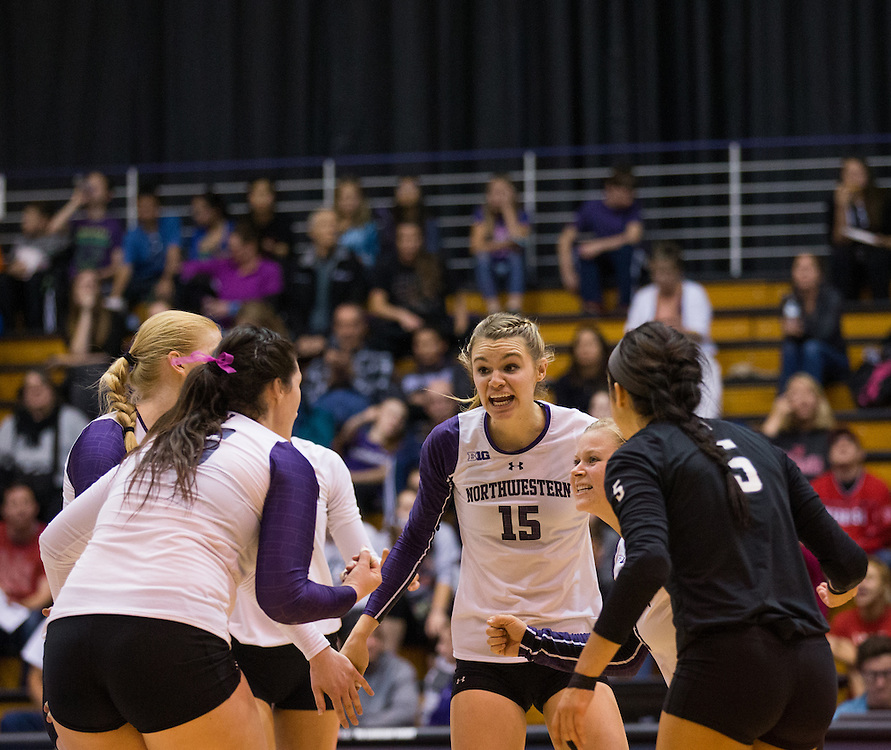 Kayla Morin (15) of Northwestern University celebrates after winning a point during a NCAA Division I Volleyball match between Northwestern University and the University of Nebraska at Welsh-Ryan Arena on October 16, 2015 in Evanston, Illinois. (Dustin Satloff)