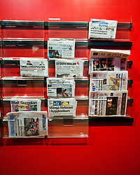 Newspaper rack inside Kulturhuset in Sergels Torg square in central Stockholm Sweden 2009