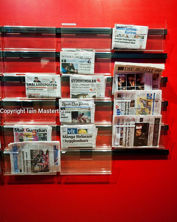 Newspaper rack inside Kulturhuset in Sergels Torg square in central Stockholm Sweden 2009