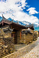 Home to the Naxi people with buildings are made of stone is the  village of Yuhu,  at the foot of the Jade Dragon Snow Mountain. The village was the residence from 1921-1949 of Austrian-American (National Geographic contributor) Joseph Rock, a geographer, linguist and botanist.