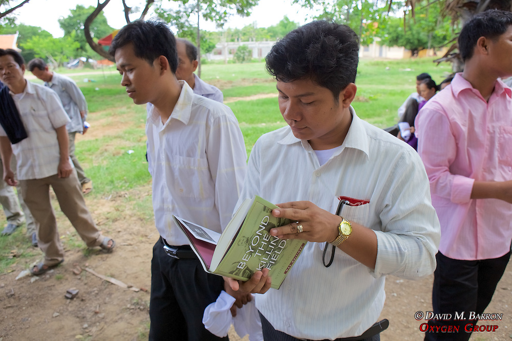 Khun Bunlee With Book Given To School By Sydney Schanberg