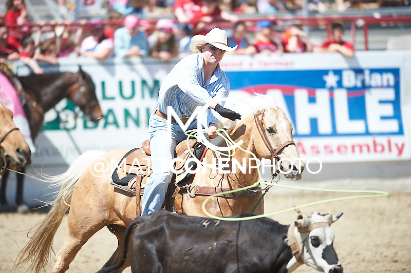 Team roper Brady Wakefield of O'Neill, NE competes at the Redding Rodeo in Redding, CA.<br /> <br /> <br /> UNEDITED LOW-RES PREVIEW<br /> <br /> <br /> File shown may be an unedited low resolution version used as a proof only. All prints are 100% guaranteed for quality. Sizes 8x10+ come with a version for personal social media. I am currently not selling downloads for commercial/brand use.