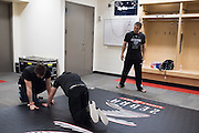 Houston, Texas - February 19, 2016: Ken Shamrock watches his sons, Sean, left, and Ryan, right, set up mats backstage before his fight against Royce Gracie during Bellator 149 at the Toyota Center in Houston, Texas on February 19, 2016. (Cooper Neill for ESPN)