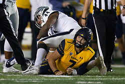 California quarterback Chase Garbers (7) looks up from where he was sacked by Nevada defensive end Daniel Grzesiak (44) during the fourth quarter of an NCAA college football game, Saturday, Sept. 4, 2021, in Berkeley, Calif. (AP Photo/D. Ross Cameron)
