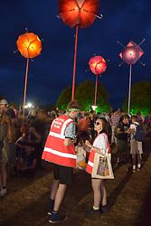 Latitude Festival, Henham Park, Suffolk, UK July 2019. Solar umbrella llights & Helpful Arena Team