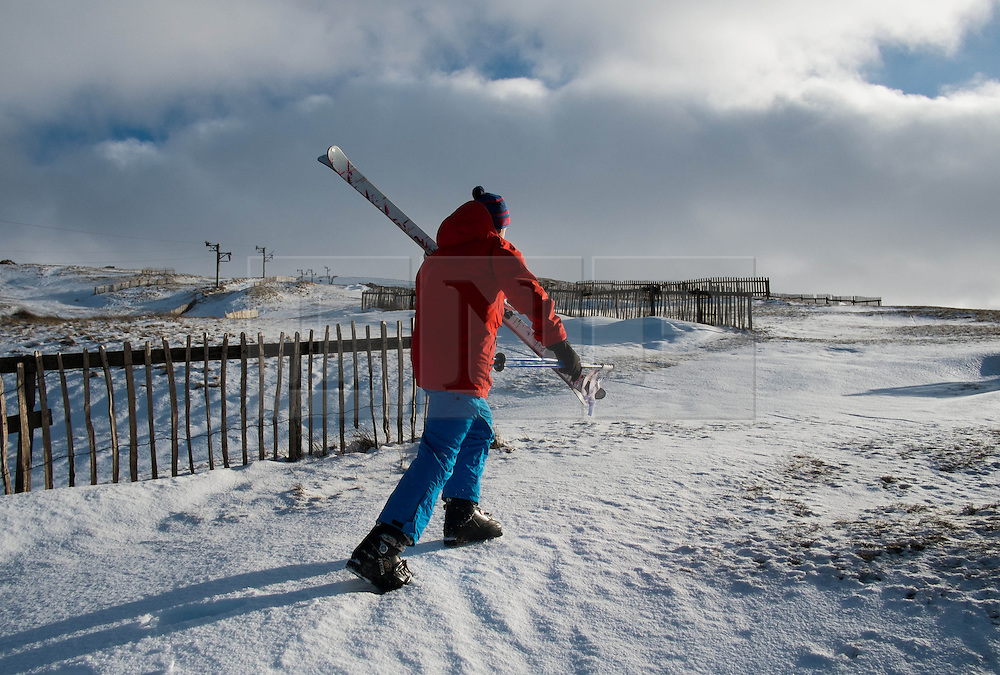 © Licensed to London News Pictures. 01/02/2014<br /> North Pennines, United Kingdom. Jonathan Cairns, 21, from Newcastle heads up into the hills above Alston to go skiing as snow covers the hills of the North Pennines. Photo credit : Ian Forsyth/LNP