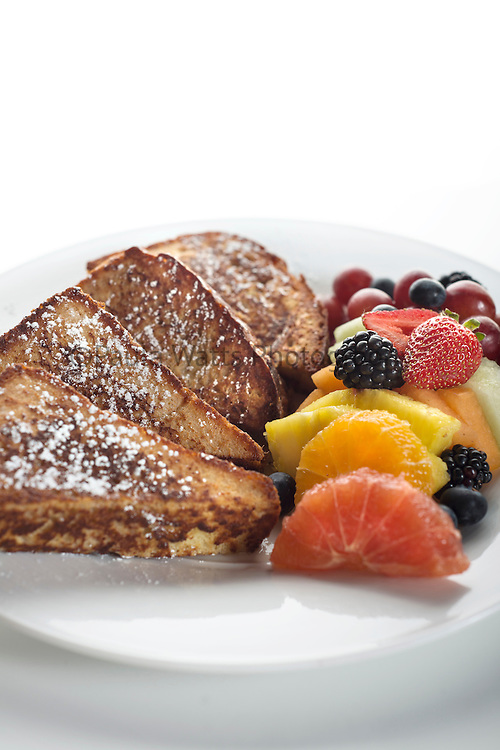 Breakfast french toast with powdered sugar and fresh fruit