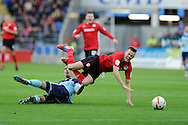 Cardiff city's Craig Noone is tackled by Boro's Seb Hines, a challenge for which the Boro player is booked for. NPower Championship, Cardiff city v Middlesbrough at the Cardiff city stadium in Cardiff in South Wales on Saturday 17th November 2012.  pic by Andrew Orchard, Andrew Orchard sports photography,