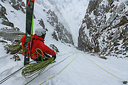 Timmy Cohn rappelling into a couloir in the Tetons, Wyoming