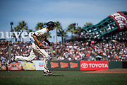 San Francisco Giants second baseman Kelby Tomlinson (37) runs to first base on a hit against the Los Angeles Dodgers at AT&T Park in San Francisco, California, on April 27, 2017. (Stan Olszewski/Special to S.F. Examiner)