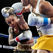 Melissa Parker (R) fights Maria Roman during a One For All Promotions boxing event at the Caribe Royale Orlando Events Center on Saturday, February 20, 2021 in Orlando, Florida. (Alex Menendez via AP)