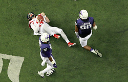 Dec 31, 2014; Atlanta , GA, USA; Mississippi Rebels quarterback Bo Wallace (14) reacts after being sacked by TCU Horned Frogs defensive tackle Terrell Lathan (90) as  Chris Bradley (97) looks on during the second quarter in the 2014 Peach Bowl at the Georgia Dome. Mandatory Credit: Kevin Liles/CFA Peach Bowl via USA TODAY Sports