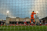 Scotland Keeper Cieran Slicker (Mancester City) punches away the ball during the U17 European Championships match between Scotland and Poland at Firhill Stadium, Maryhill, Scotland on 26 March 2019.