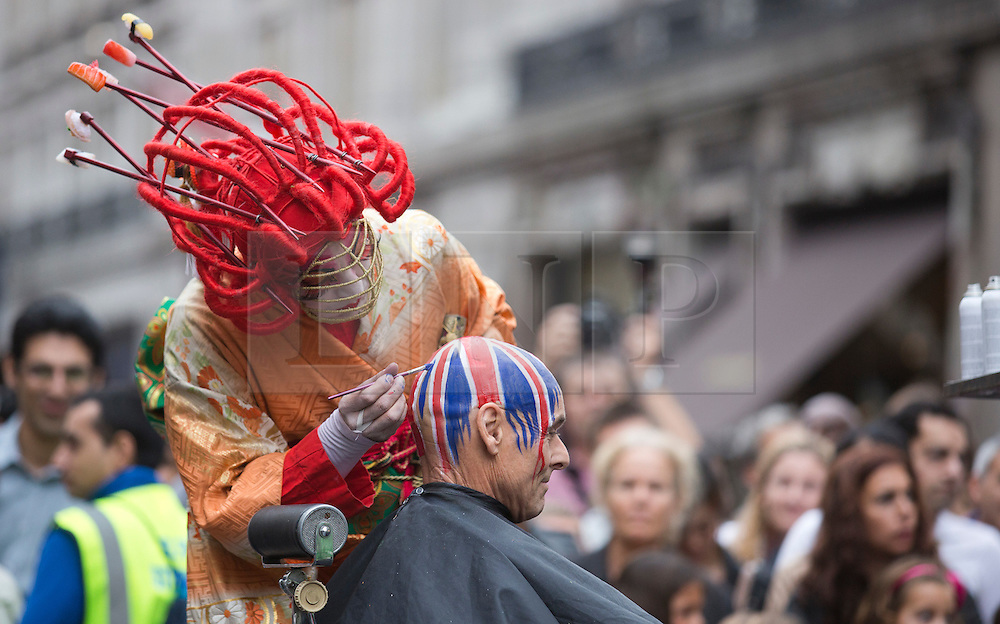 © Licensed to London News Pictures. 02/09/2012. London, England. Pictured: Osadia (Spain) - quirky hair transformations. Piccadilly Circus Circus with performers just for one day, in celebration of the London 2012 Games. Central London around Piccadilly Circus has been transformed into a Circus arena with acrobats and performers. Part of the London 2012 Festival. Photo credit: Bettina Strenske/LNP
