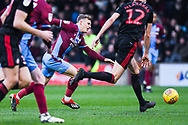 George Thomas of Scunthorpe United (18) sees the ball just run away from him during the EFL Sky Bet League 1 match between Scunthorpe United and Sunderland at Glanford Park, Scunthorpe, England on 19 January 2019.